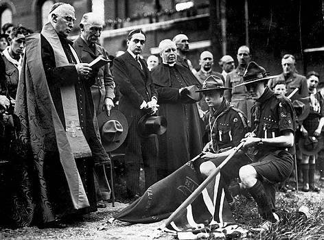 Archbishop of Westminster Francis Cardinal Bourne (with Lord Baden-Powell to his left) blessing a troop's colors